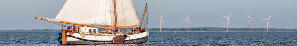 Traditional Dutch Tjalk and windmills